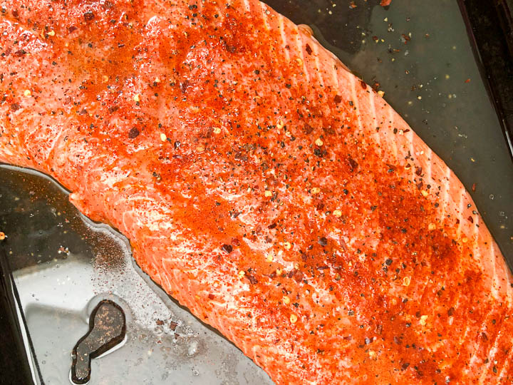 seasoned salmon on quarter size baking sheet