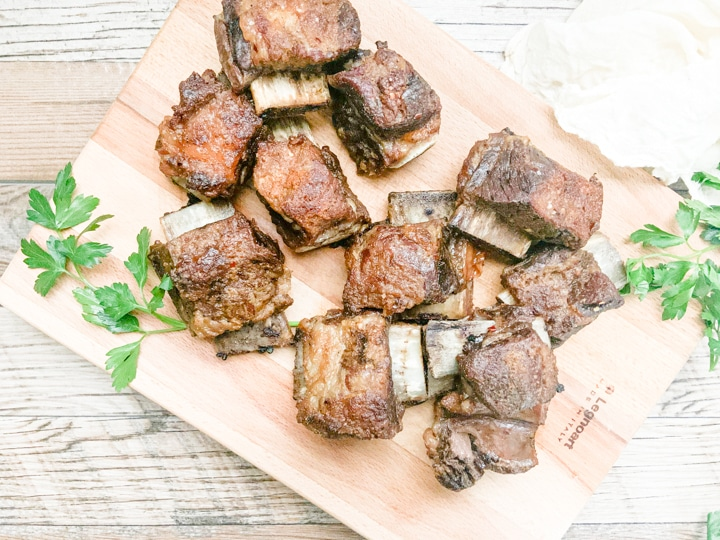 baked beef short ribs served on a cutting board