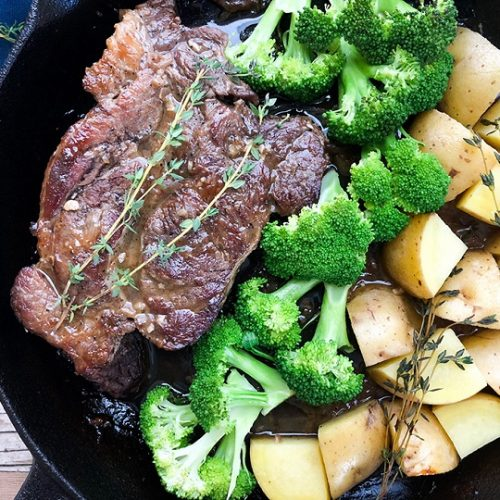 oven baked chuck roast recipe in cast iron skillet with potatoes and broccoli