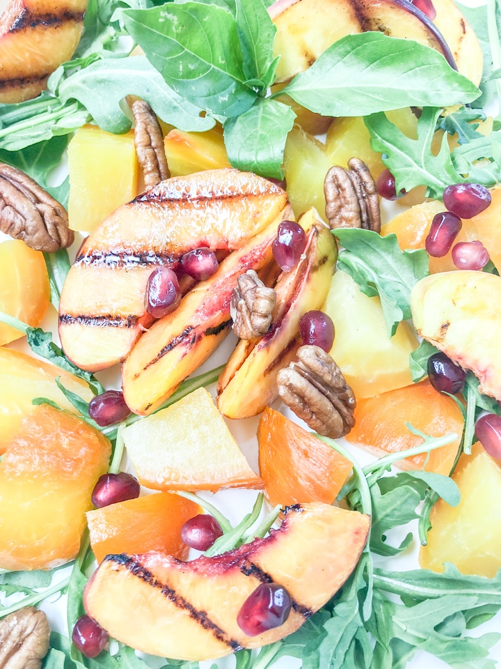 close up of vegan roasted beet salad with grilled peaches