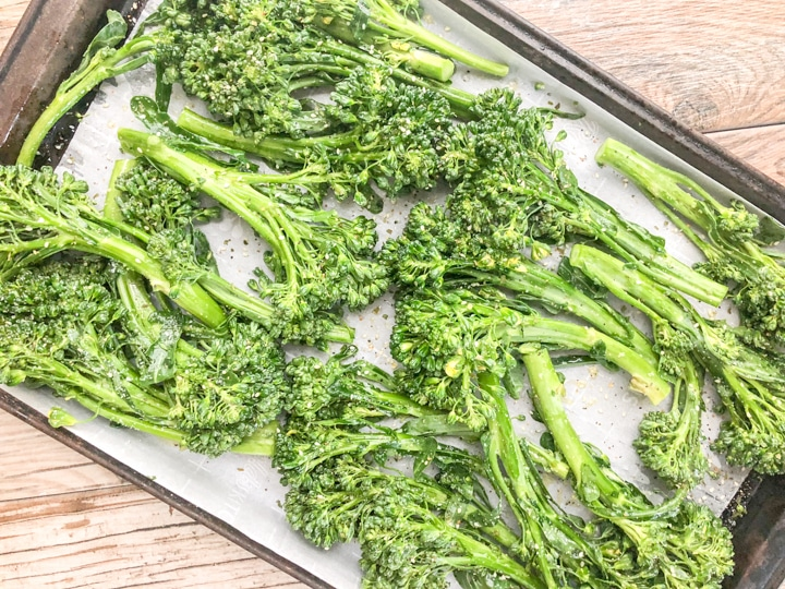 prepping oven roasted broccolette recipe before roasting