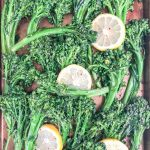 oven roasted broccolette recipe in sheet pan and garnished with lemon