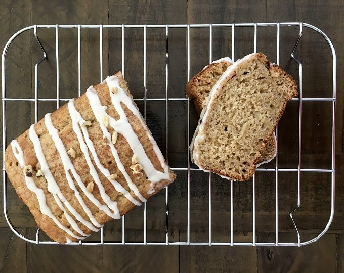 Healthier Banana Bread with vanilla glaze drizzled on top
