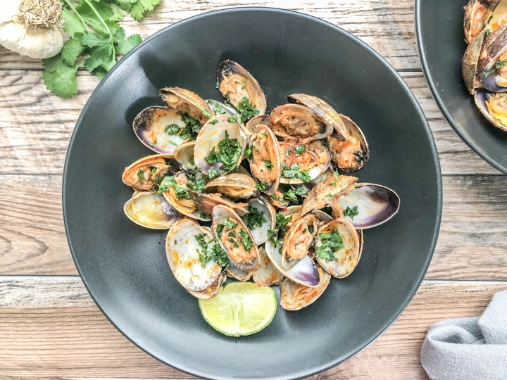 over head shot of steamed clams in black bowl