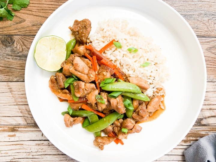 healthy chicken stir fry served on white plate