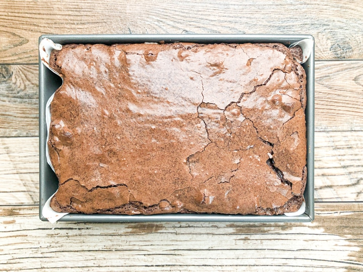 brownie cookie out of the oven in baking pan