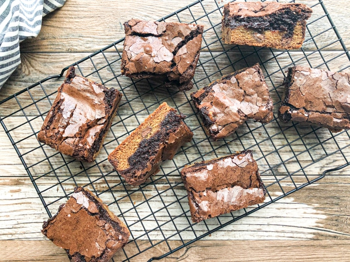 brownie cookie square layed on its side with brownie and cookie layer showing