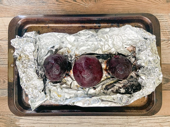 roasted beets that have been taken out of oven in unwrapped foil