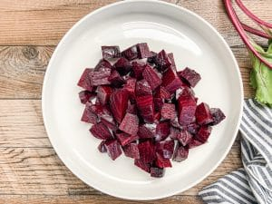 roasted beets cut into chucks on white plate