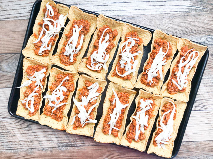 taco shells filled with turkey taco meat and shredded cheese