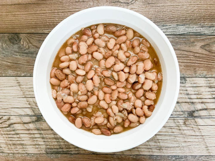 pinto beans served in round white bowl
