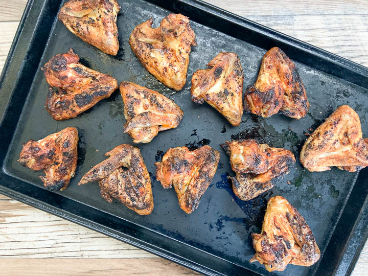 grilled chicken wings on baking sheet