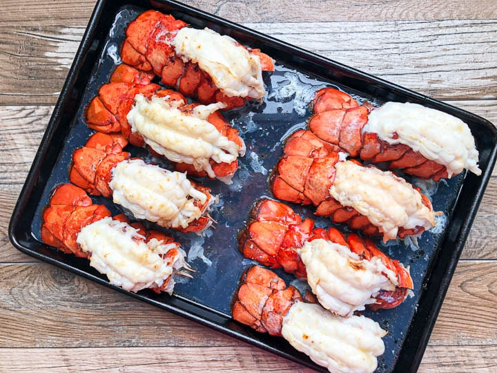 broiled lobster tails on baking dish out of oven