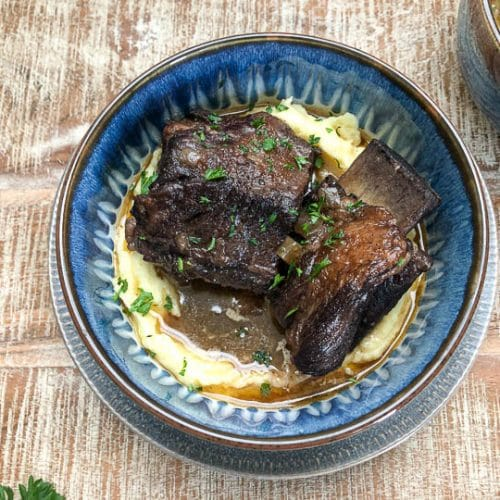 braised beef short ribs in blue bowl