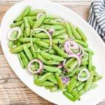snap peas on white serving platter