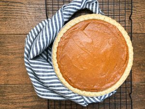 close-up of sweet potato pie next to striped gray napkin
