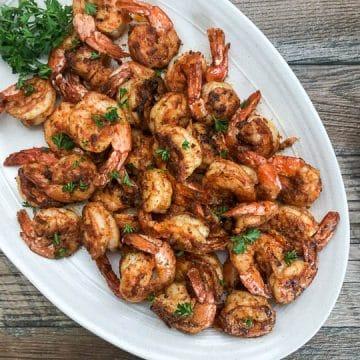 seared shrimp on white servering platter