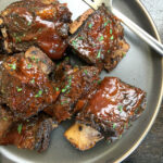 baked beef short ribs on blue plate