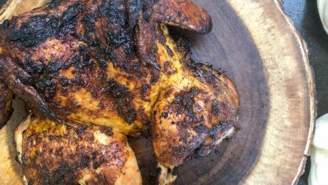 grilled chicken on wooden platter