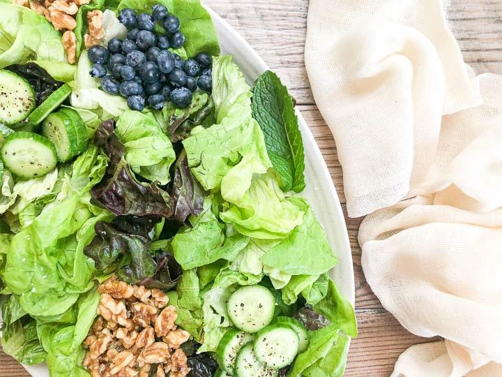 close up image of spring mix salad on platter