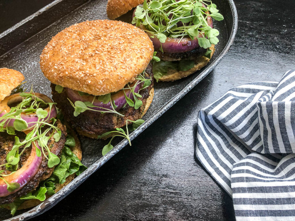 3 open-faced turkey burgers with grilled onions and lettuce