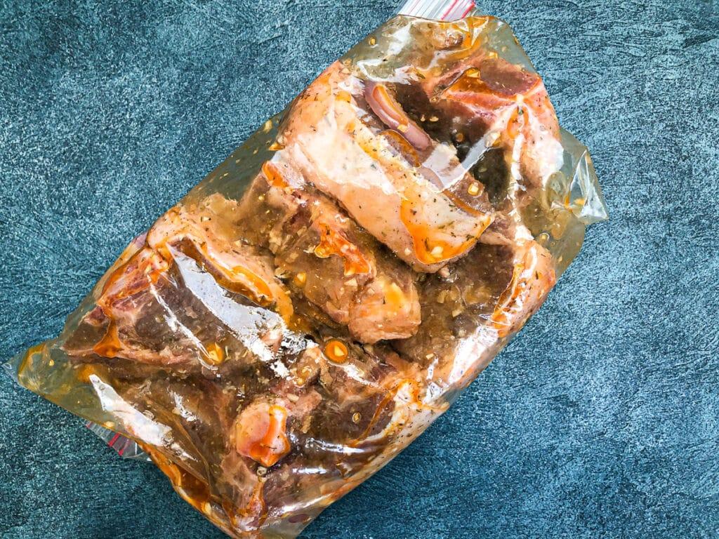 lamb chops marinating in ziploc bag