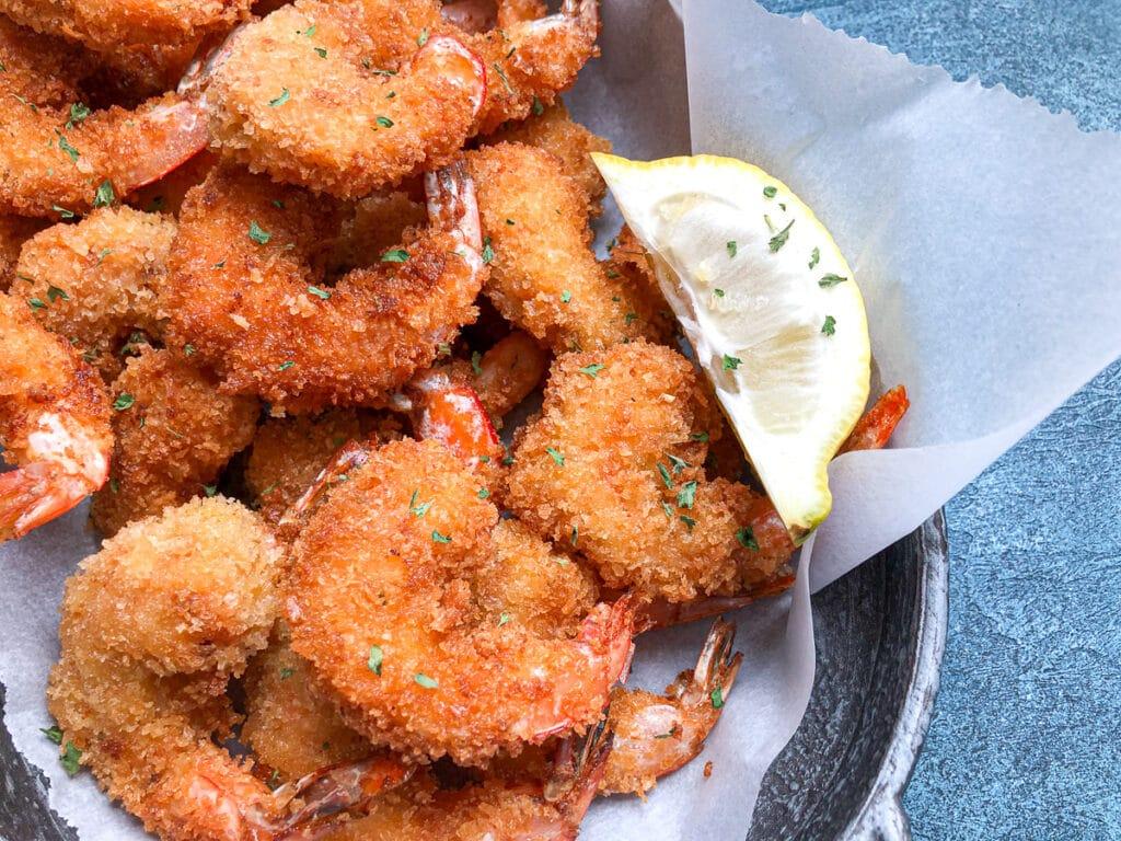 close up shot of fried shrimp in platter for tacos