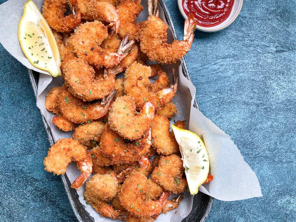 over head view of panko fried shrimp in oval platter.