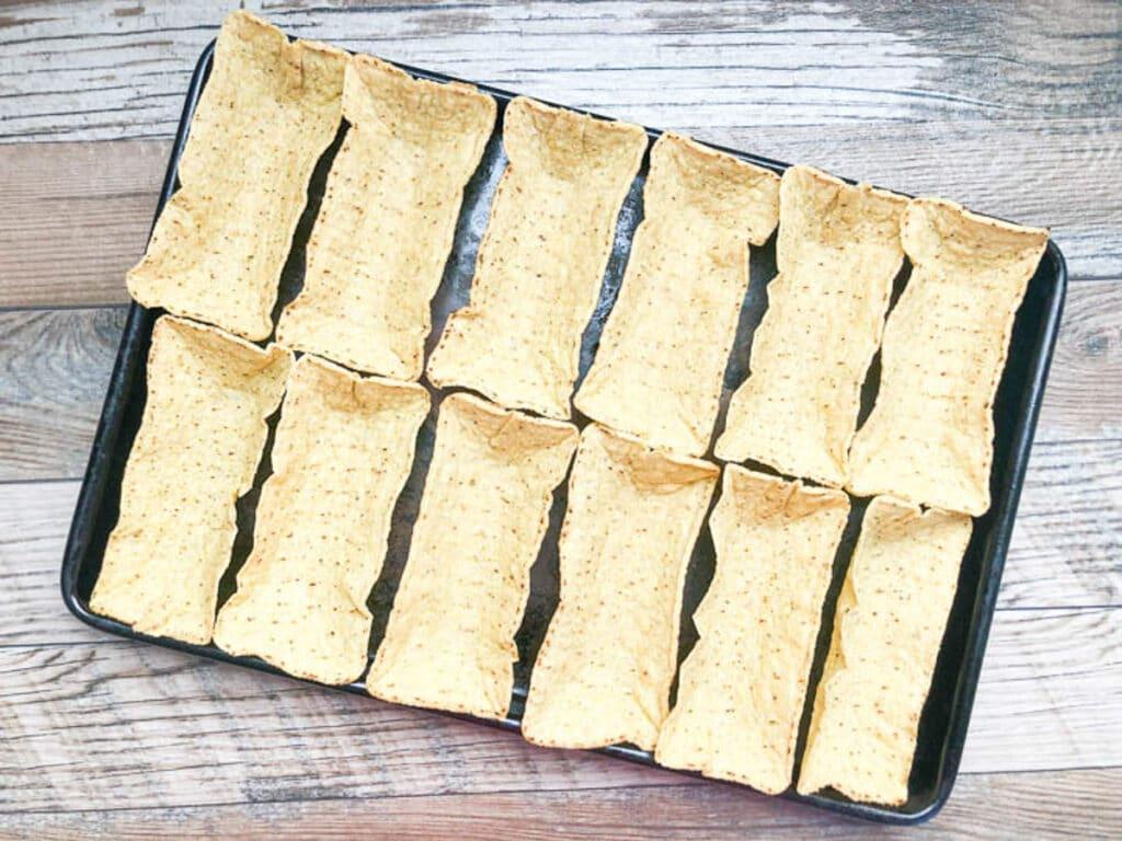 crispy taco shells on baking sheet.