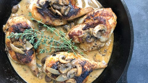 roasted cornish hens in white wine sauce in cast iron skillet